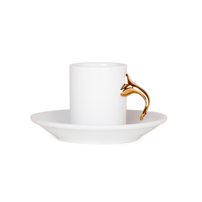 WHITE CUP OF COFFEE WITH PLATE WITH A LEAF KNOB AS A HANDLE